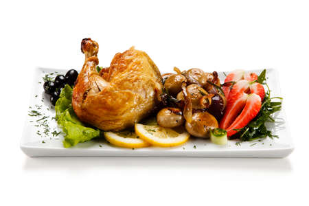 Roast chicken leg with mushrooms Stock Photo
