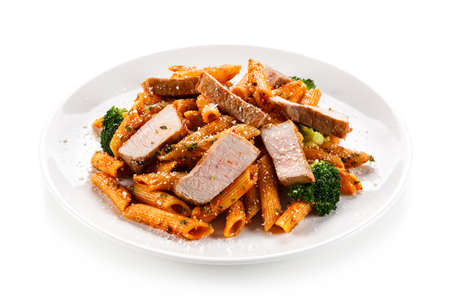 Pasta with vegetables on white background