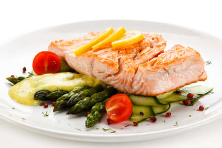 Grilled salmon with asparagus on white background Stock Photo