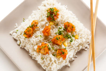 Chicken nuggets with rice on white background