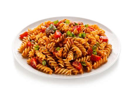 Pasta with tomato sauce on white background Foto de archivo