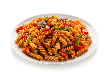 Pasta with tomato sauce on white background Фото со стока