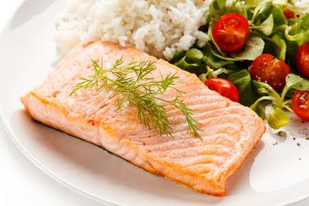 Roast salmon with white rice on white background