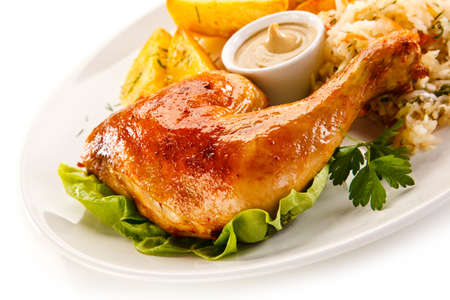 Grilled chicken leg with cheese and vegetables on white background