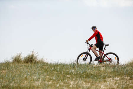 cross street: Young man biking outdoor Stock Photo