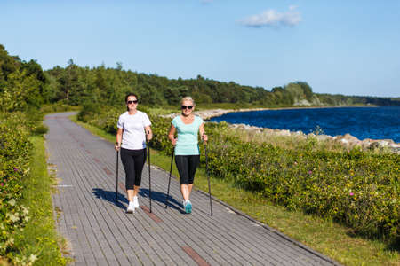 Nordic walking - active people working out in park 免版税图像 - 85346784