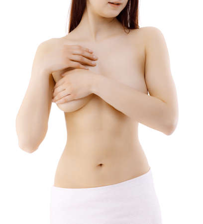 Woman examining her breast isolated on white background Stock Photo