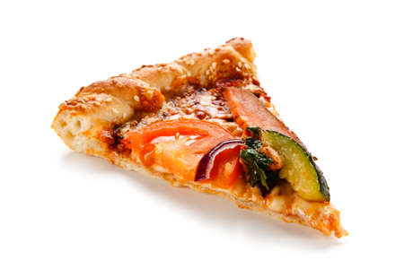 Piece of pizza with bean and vegetables