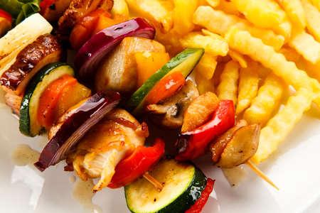 Shashlik - Grilled Meat with Vegetables on White Background