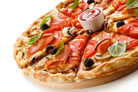 Pizza with ham, tomatoes, mushrooms and olives