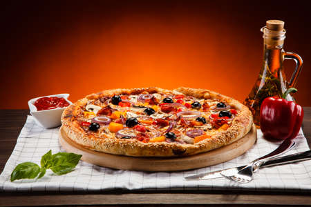 Pizza with black olives Stock Photo