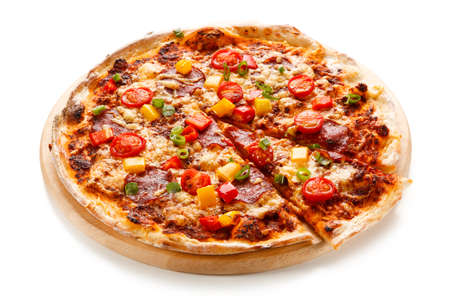 Pepperoni pizza with tomatoes, mushrooms and pepper