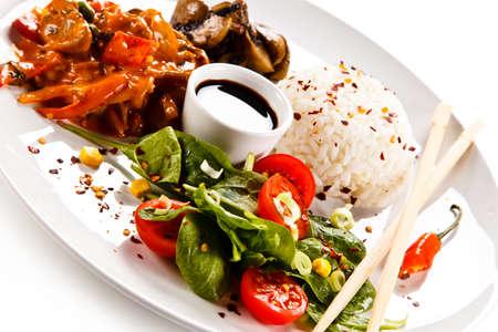Rice dish with goulash on white background