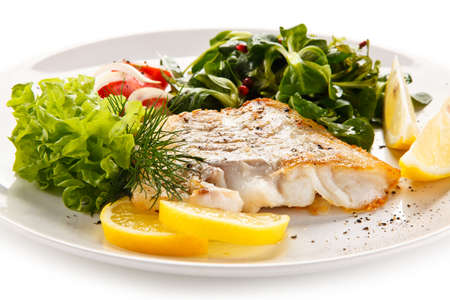 grill: Fish dish - fried fish fillet and vegetables Stock Photo