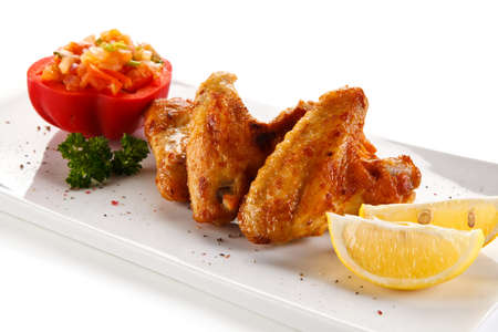 Fried chicken wings with vegetables