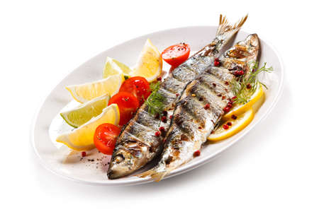 Fish dish - grilled herrings with vegetables