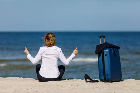 Businesswoman relaxing on beach beside the suitcase Stok Fotoğraf - 90420139