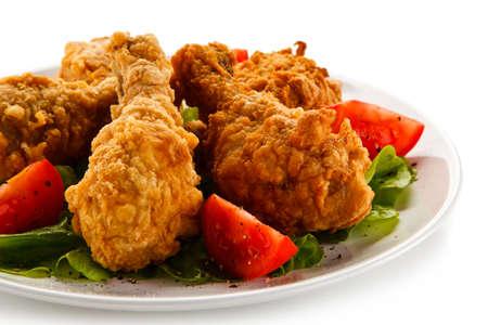 Fried chicken drumsticks on white background