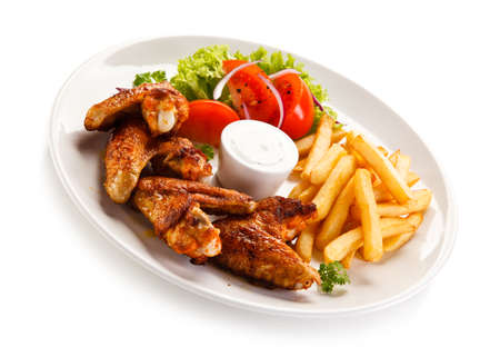 Fried chicken wings with french fries