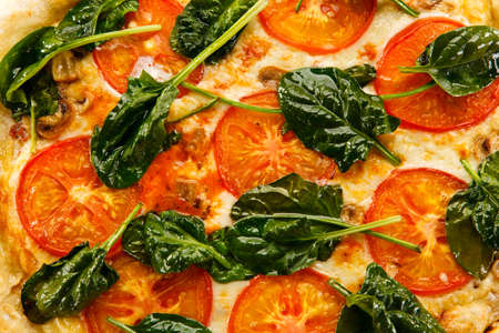 Pizza with spinach an tomatoes