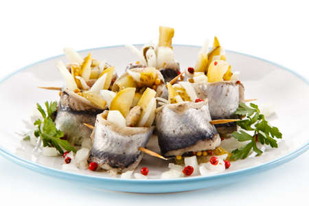 Marinated herring fillets on a white background Stock Photo