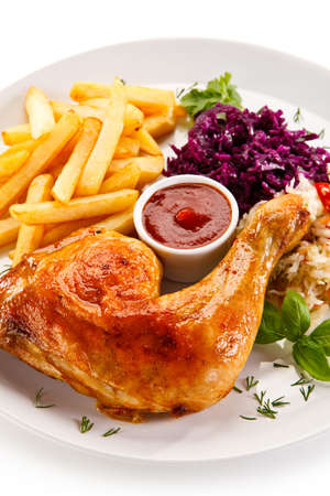 Chicken leg with french fries and vegetables Stock Photo
