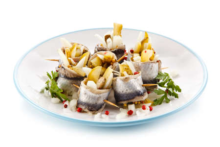 Marinated herring fillets on a white background Stockfoto