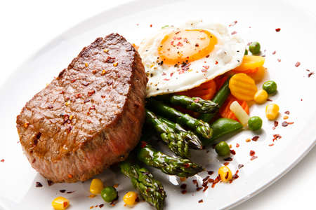 Grilled steak with asparagus and fried egg
