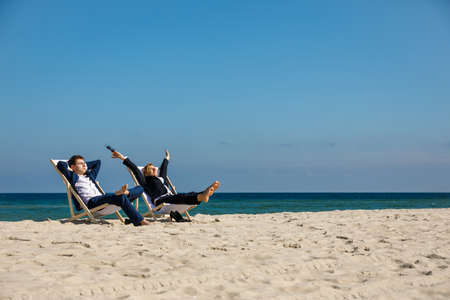 Woman and man relaxing on the beach