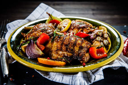 Barbecued chicken legs with vegetables Stock Photo