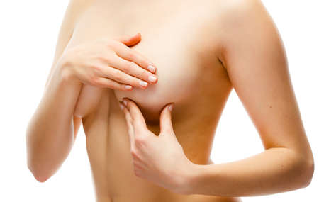 Woman examining breast isolated on white background Stock Photo