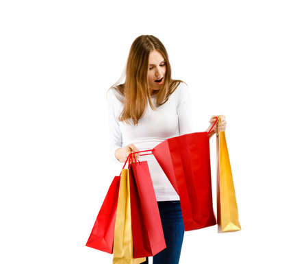 Young woman holding shopping bags isolated on white background Stock Photo