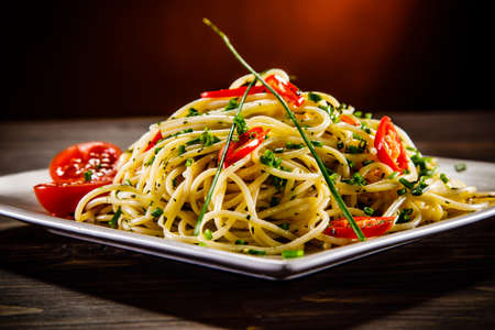 Spaghetti with tomatoes and chives Stock Photo