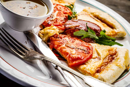 Pizza with salami and vegetables Stock Photo