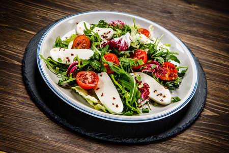 Greek salad on wooden background
