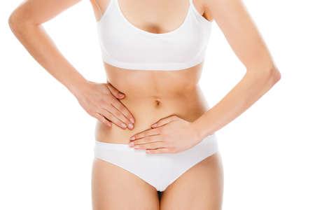 Woman massaging stomach pain Stock Photo