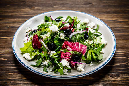 Salad with cottage cheese on wooden background 写真素材