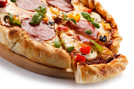Pizza pepperoni with salami, mushrooms and olives
