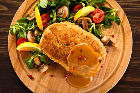 Stuffed pork chop with boiled potatoes and vegetables Standard-Bild