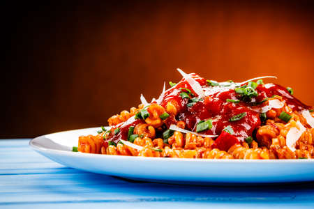 Fusilli with meat, tomato sauce and vegetables Stock Photo