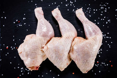 Raw chicken legs on wooden background Stock Photo