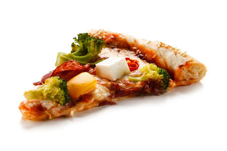 Piece of pizza with salami and feta cheese on white background