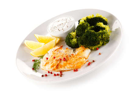 Fried fish fillet with broccoli on white background