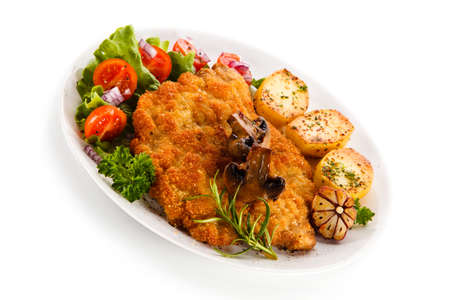 Fried pork chop with potatoes on white background 免版税图像