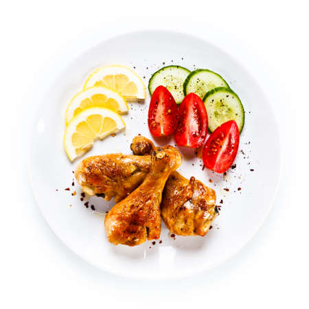Drumsticks with vegetables on white background 스톡 콘텐츠