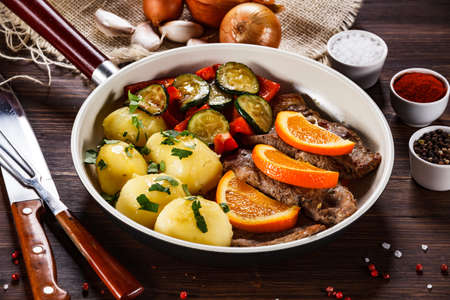 Grilled steak, boiled potatoes and vegetables Stock Photo