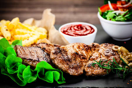 Grilled beefsteak with french fries Stock Photo