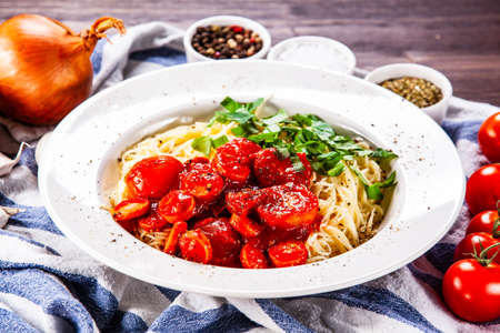Pasta with tomato sauce and sausage