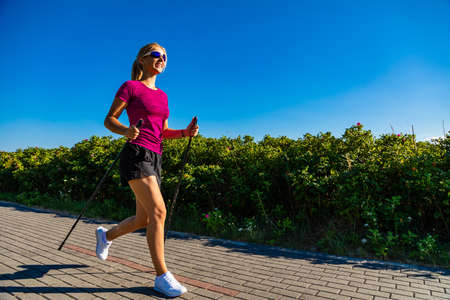 Nordic walking - young woman training 스톡 콘텐츠