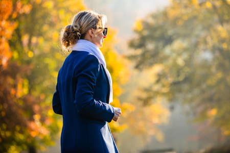 Middle-aged woman walking in city park